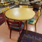 Finish shows use but is not worn. Legs show more wear. 1550 Round table in original Wheat.