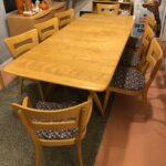 197 Triple pedestal table  fully opened with both extension leaves with 6+2 Dogbones. Previously refinished by another dealer in an acceptable Wheat, used and in excellent condition with very few surface marks.  Newer upholstery too. suite - sold
