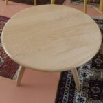 in curly maple with a clear (natural) finish. custom revolving coffee table
