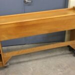 M780 full size cabinet utility headboard. Original Wheat. Other than finish wear and discoloration where obvious across the actual headboard, the condition is excellent.