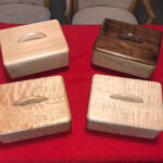 Only four left. Quilted Maple (fr.left) $275 Curly Maple (fr. right) $275 Natural Birch (rear left) $175 Walnut top on Sycamore $275 Custom made jewelry boxes