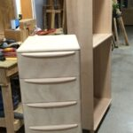 Three drawer filing cabinet in the raw