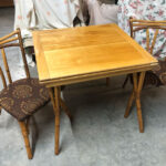 Table opens to twice the length. Table has previously been refinished Natural and is in very good/excellent condition. $450 game table with two chairs