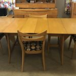 full opened with both leaves with four cat eye chairs newly upholstered. All in excellent condition  Table and chairs 1549 Harmonic dining table